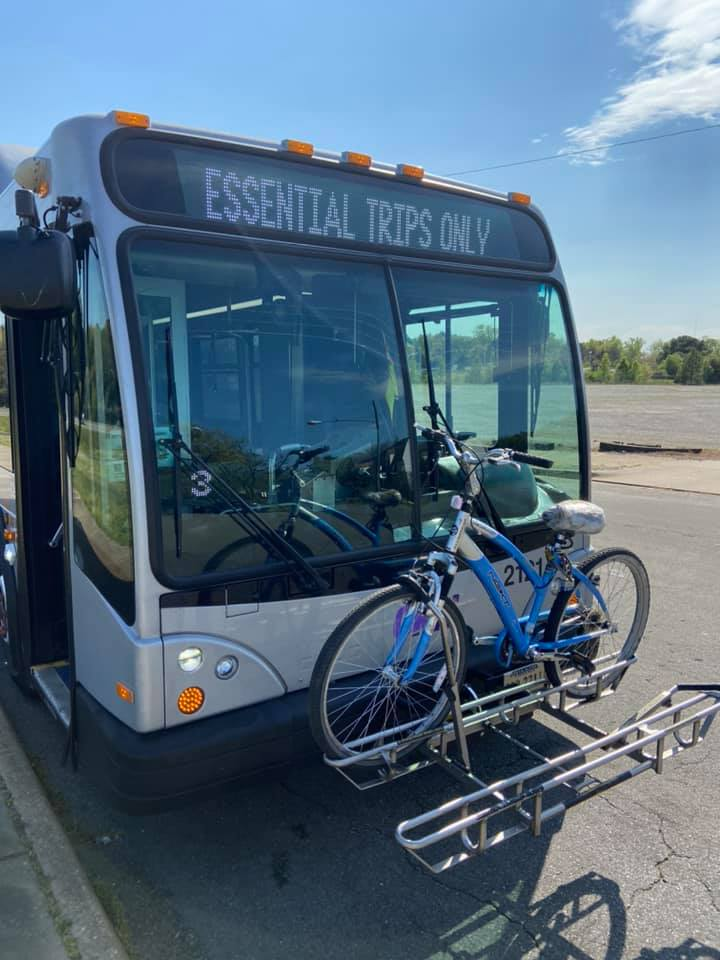 Bus with bike on front, saying Essential Trips Only