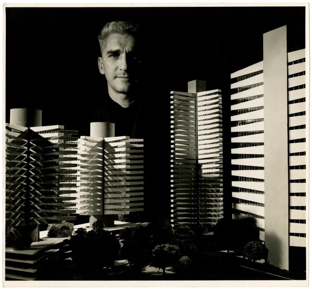 "Haigh Jamgochian with models of his proposed revolving hotels (left) and ""Tree House"" apartment building (right), 1960s"