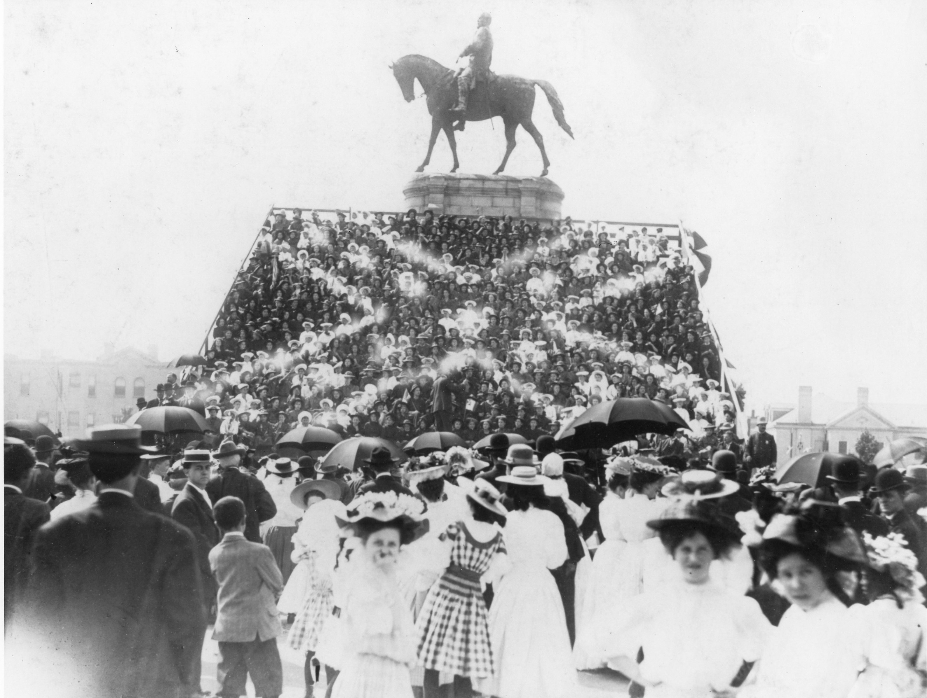 The Lee Monument, decorated with a human Confederate battle flag during the unveiling of the J.E.B. Stuart Monument