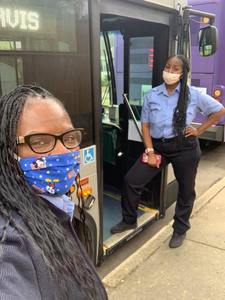 two bus operators wearing face masks