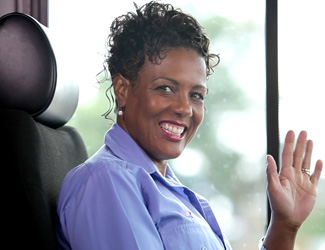GRTC bus driver greets passengers with a smile