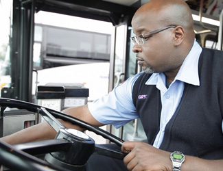 GRTC driver prepares to pull away from bus stop